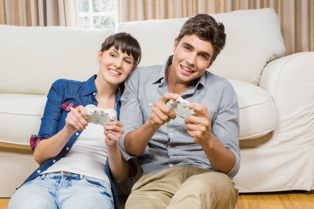 couple-playing-video-game-their-living-room